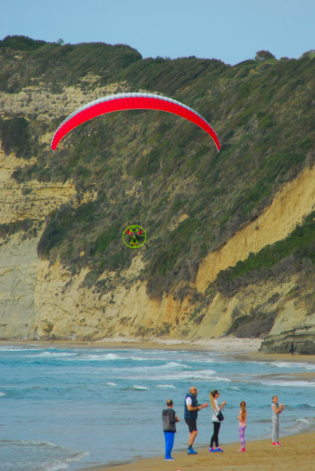 Paramotor heading towards the clif  at Arillas north Beach